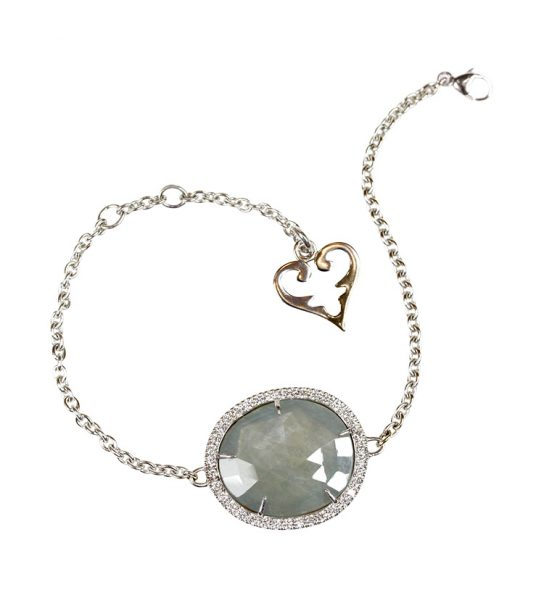 Lovely one of a kind bracelet in organic shape featuring a flat grayish blue Saphire surrounded by Diamonds. Wear this on your wedding or for more glamour at daytime.