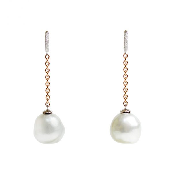Elegant long earrings with enormous barock shape cultured South Sea Pearls with little diamond hoops connected by a string of chain in Red Gold 18k.