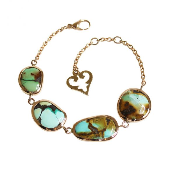 One of a Kind oval link chain bracelet with 4 turquoises and their matrix in interesting organic shape, hand set in Rosegold 18k.